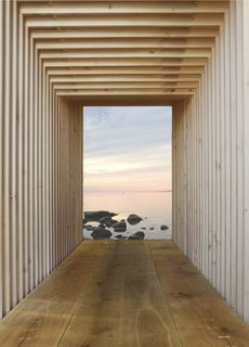 """Kajakhuset by In Praise of ShadowsThis """"kayak house"""" is a sleek boathouse with a utilitarian interior that can be adapted for myriad other uses. Constructed like Legos from similar pieces of wood, the structure is capped by two glass doors."""