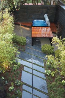 10 Modern Hot Tubs - Photo 4 of 10 - Parallelogram-shaped stone slabs line the walkway to the hot tub.