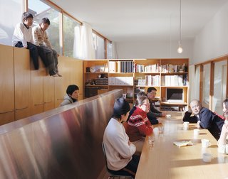 "Hidekazu Higashibata wanted to recreate the same sort of feeling he'd experienced on trips to Italy—a long table, leisurely meals, and lengthy conversations. The boys discovered the home's ""second story"" on top of the cabinetry and, armed with a ladder, like to perch there for better views."