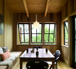 This dining nook is fully clad in Western cedar, augmenting the home's connection to the outdoors.