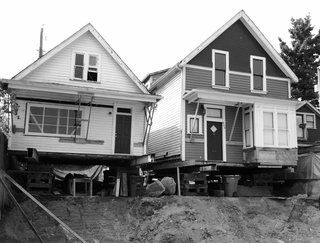 As Housing Costs Soar, Two Homes Multiply to Seven - Photo 2 of 7 - The original structures were lifted from their foundations to accommodate new ground-floor units.