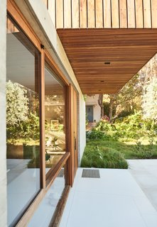For the Highest Green Honor, One Couple Pulls Out All the Stops - Photo 7 of 12 - The house was designed as a long, linear structure to accommodate the residents' request that visitors always feel connected to the site as a whole.