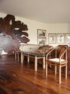 The lesson of the ancient redwood—a pillar of its ecosystem for centuries, quickly felled by humans with little understanding of their actions—is an integral part of Shope's new home, built with reclaimed materials and filled with wood furnishings made by his own hand. Carefully crafted, the black walnut floor fits like a jigsaw puzzle.