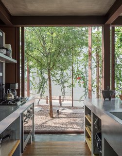 The Lowreys works with architect Luis Sanchez and a team of local craftsmen to complete the build. The custom counters in the kitchen are terrazzo and granite; the oven and cooktop are from Teka.