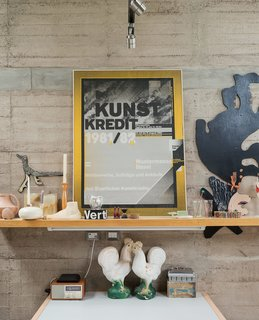 A collection of flea-market finds and personal keepsakes sit perched upon a shelf in Austin's studio.