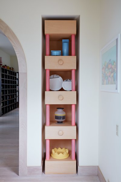 A tall custom niche displays various tabletop items Sottsass designed for brands Habitat, Memphis, Egizia, and Anthologie Quartett.  Photo 5 of 14 in Thank Sottsass for the Most Memphis House Imaginable