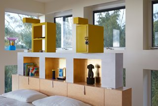 "Renzo Brugola, a Memphis designer and cabinetmaker, built the custom bed and headboard in the master bedroom. Sottsass designed both, as well as the yellow storage units, adding a door and a lock to one of them ""for the purpose of putting in our love letters,"" notes Adrian."