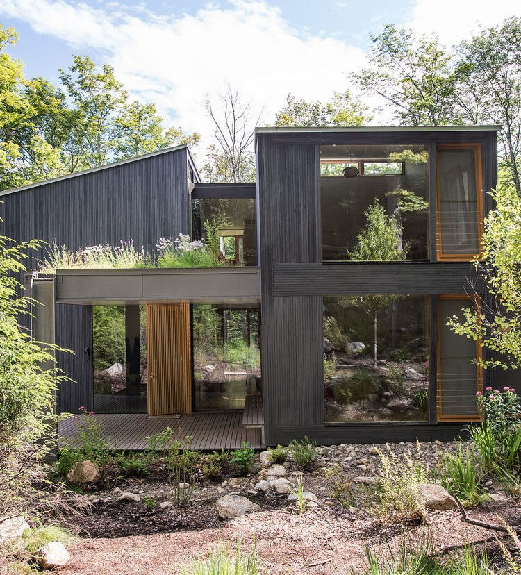 Exterior, House Building Type, and Wood Siding Material In upstate New York, two families unite to design a vacation house that will suit all their needs for years to come.  Photo 4 of 5 in A Dream Home is an Architectural Self-Portrait