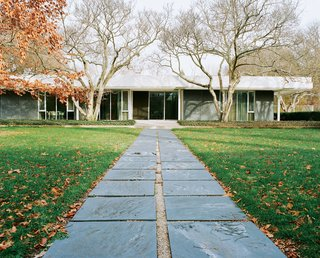 Eero Saarinen's legendary Miller House opened to the public in May 2011 for the first time. The pathway from the pool to the house is paved with the same slate that clads the exterior walls.