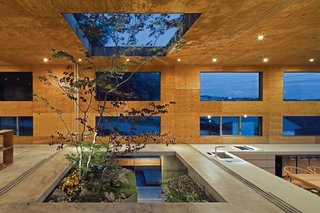 "The building is composed of a partially-buried concrete box covered with a well-insulated cedar-and-larch shell (what Maeda calls ""the nest"" and ""the fallen leaves"")."