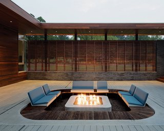 """We didn't want the pit to be an obtrusive contraption sitting in the center of a zen-like courtyard,"" says architect Matthew Hufft. A low-profile fire pit is the perfect continuation of a mellow Missouri backyard. Photo by Mike Sinclair."