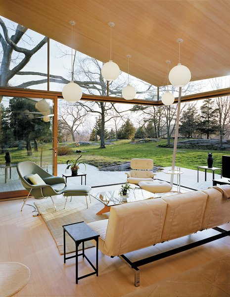 Design Classic: Eero Saarinen's Womb Chair - Photo 3 of 10 - In this Connecticut cottage, classic modernist staples, such as the Womb chair, an Eames lounge chair, and an Eileen Grey E1027 side table, look at home alongside newer pieces, such as an Encore sofa from Room & Board and a Doka rug designed and produced by Stephanie Odegard. Photo by Mark Mahaney.