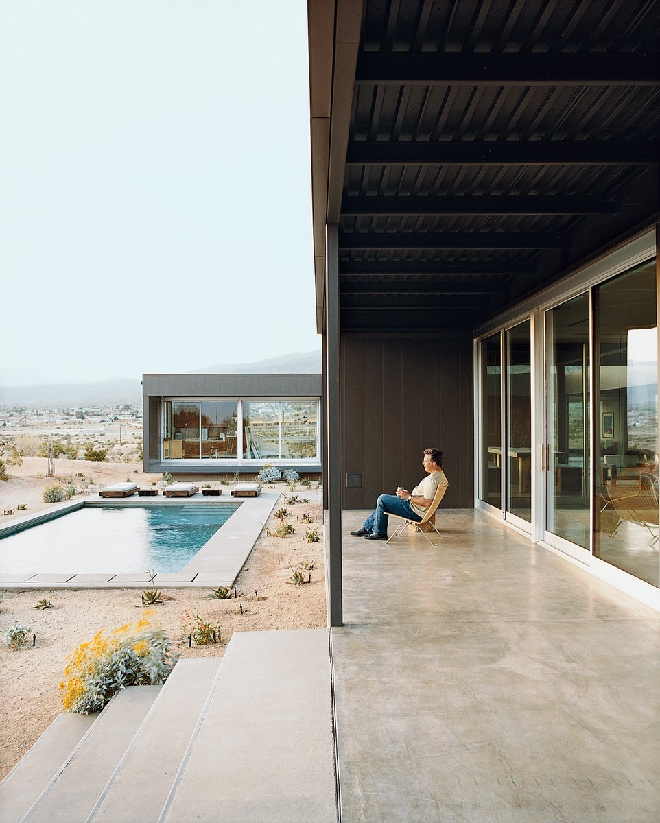 Concrete Pools, Tubs, Shower, Large Patio, Porch, Deck, Back Yard, Large Pools, Tubs, Shower, Desert, Exterior, and House Building Type Composed of primarily steel, this prefab home has sufficient outdoor space. Photo by: Daniel Hennessy  Photo 1 of 23 in 20 Desert Homes from Modern Swimming Pools