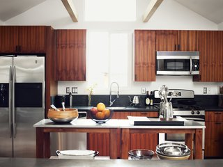 Inspired Indoor Teak Looks - Photo 7 of 14 - He worked with Kartheiser's existing appliances in the kitchen, trading the old cabinetry for new teak.