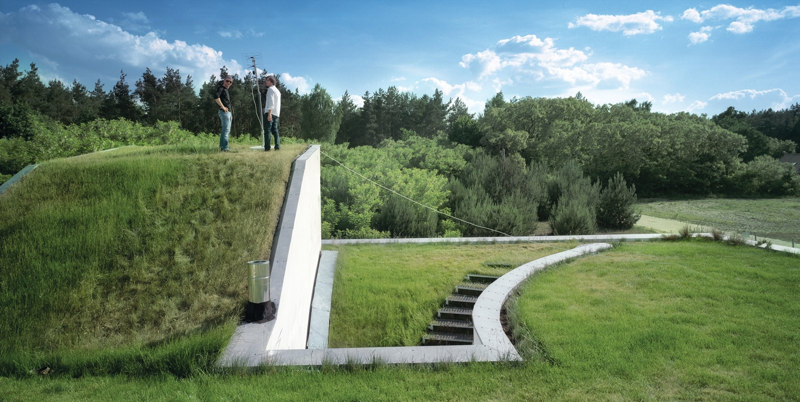 "Architect Konieczny lifted the existing ground and wrapped it around the roof and exterior rooftop staircase, essentially making all floors ""ground"" level.  Photo 1 of 3 in Modernist Rural Getaway in Poland"