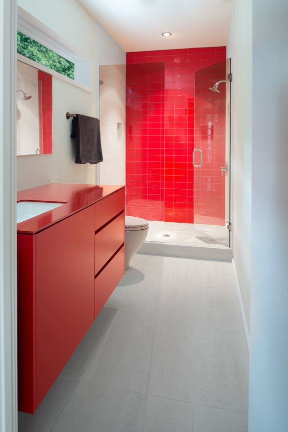 Bath Room, Undermount Sink, One Piece Toilet, Enclosed Shower, and Metal Counter The bathroom features Chromtech tile, a Toto toilet, Kohler vanity, and powder-coated steel countertop.  Photo 3 of 21 in Red, Red, and More Red! 20 Bold Interiors That Make a Statement from Modern Bathroom Design, Remodeling, and Decor Ideas