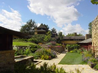 Taliesin (1911, Spring Green, Wisconsin). Wright's home and studio, rebuilt after two fires, is a peaceful retreat that demonstrates the architect's graceful merging of architecture and landscape.