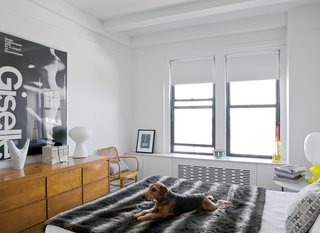Beneath the windows in the living room and the bedroom is the clever built-in radiator screen/storage system designed by Joshua Pulver and Mike. The bedroom dresser is vintage Russel Wright.