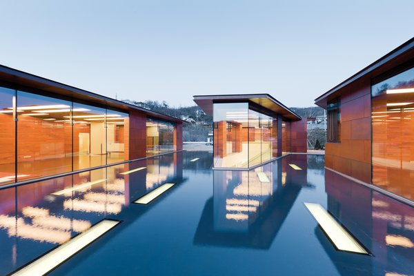 Clad in copper panels that Holl had fabricated by the Kansas City, Missouri, company Zahner, the house is daylit by a host of rectangular skylights (inspired by the musical staff) punched through the roofs and the pool's floor.  Photo 3 of 7 in Music Holl: A Copper Clad Pavilion in Seoul
