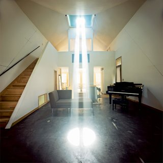 Inside the house, the speed of the planet's rotation is indicated by the rate of the light beam's movement over the floor and walls. When the Burkes first moved in, the speed of shifting light made them dizzy.