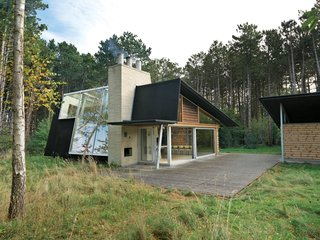 After living on and studying a woodsy acre of land in North Zealand, Denmark, architect Jesper Brask cleared a stand of pine trees and, from the timber, built a getaway that's open to its surroundings. The house, which Brask shares with his wife, Lene, and sons, Kristian, Jens, and Niels, is used mainly in summer, when the weather is optimal for throwing open the glass doors.