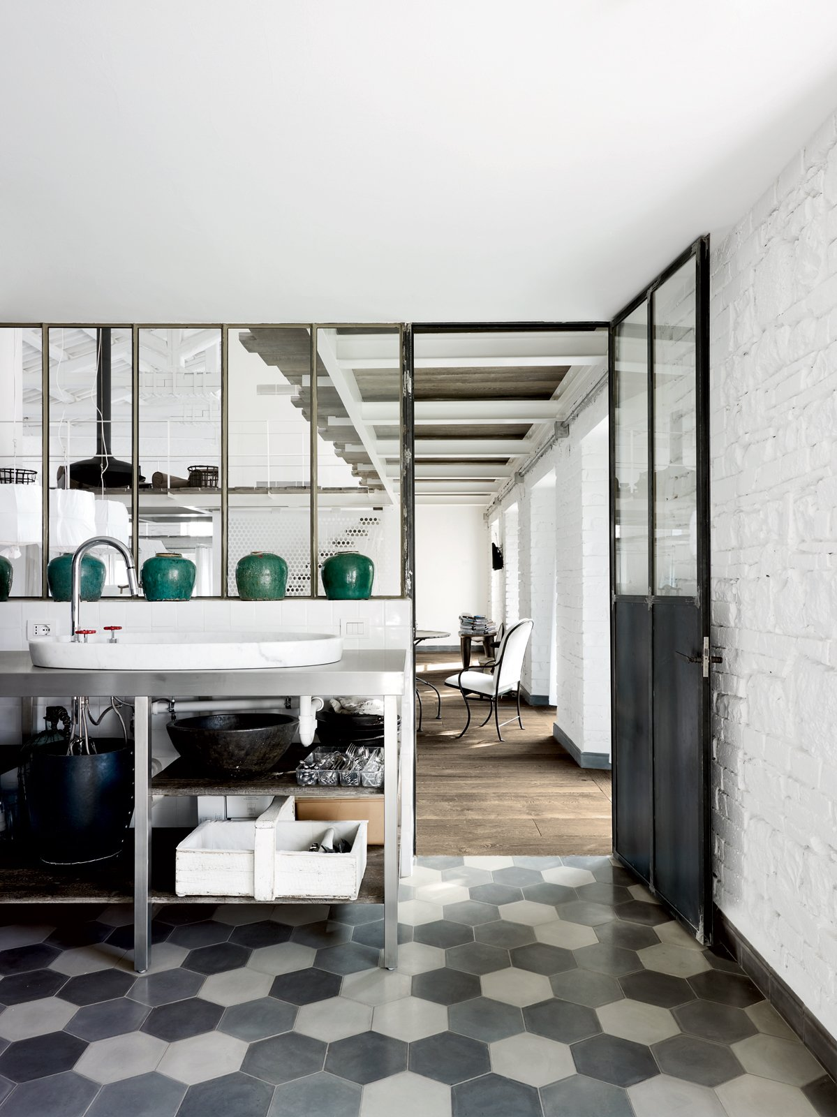 For the floors in the kitchen and throughout, Navone placed hexagonal Carocim tiles of her own design.  Photo 3 of 11 in Paola Navone's Industrial Style Renovation in Italy