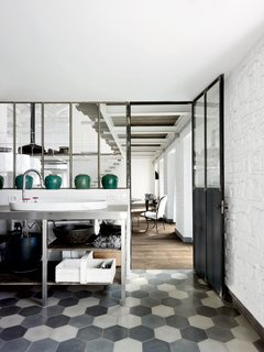 For the floors in the kitchen and throughout, Navone placed hexagonal Carocim tiles of her own design.