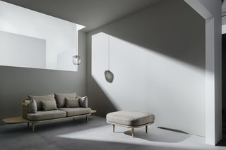 In Copenhagen, Norm Architects designed a new showroom for furniture company &Tradition, pairing a raw-concrete floor with light gray walls, neutral furniture, and a smoky gray light fixture. Although the grays of the furniture have a brown tone to them (as do the wood feet and attached side table), the overall composition is created through calm, subtle colors.