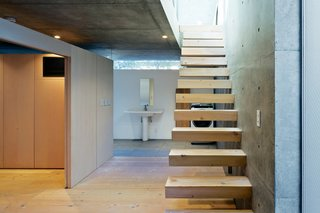 The staircase leads to the living area upstairs.