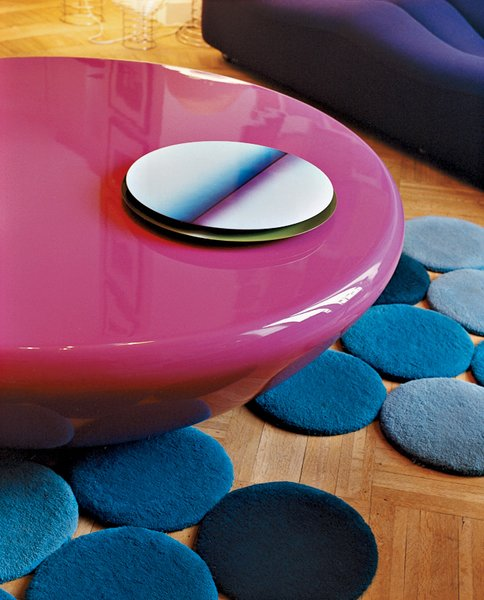 The bright pink Smarties table by Mattia Bonetti is surounded by designs by the Bouroullec brothers—a lacquered steel table center and blue rug.  Photo 11 of 14 in Like a Kid in a Candy Store