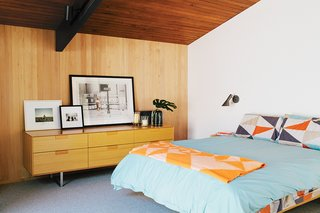 Arne Jacobsen's AJ Wall Lamps are in the master bedroom, which is furnished with a Case Study bed and a Series 11 6 Drawer Console by Blu Dot.