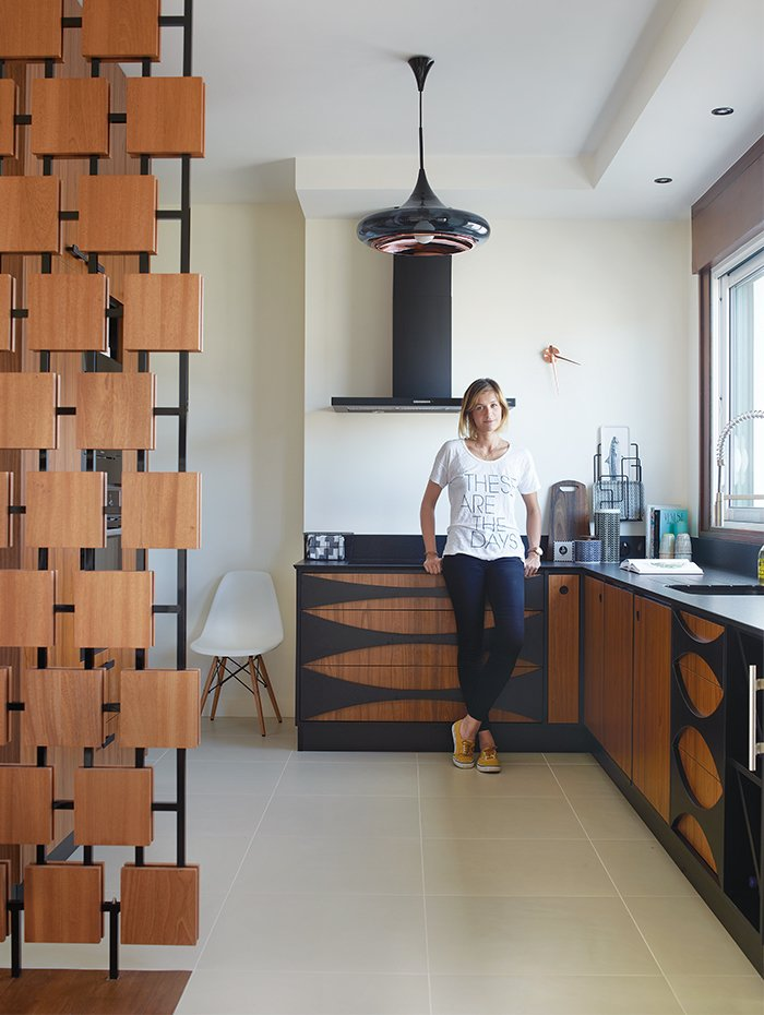 Kitchen, Ceramic Tile Floor, Wood Cabinet, and Pendant Lighting In the renovation of a 1950s building in Royan, France, interior designer Florence Deau selected a fleet of vintage and new furnishings.  Photo 3 of 10 in 10 Modern Renovations to Unique Homes in France from Editor's Picks: 4 Modern Interiors We Love