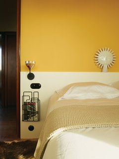 Modern Home Furnished With Flea Market Finds - Photo 5 of 17 - Farrow & Ball's Babouche yellow enlivens one of the bedrooms.