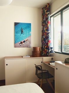 The desk and cabinets in one bedroom are custom, and the chair is Patrick Norguet for Tolix.