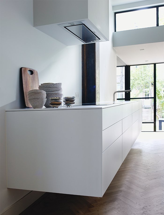 The sleek, white kitchen is by Bulthaup.  Photo 5 of 6 in A Restless Real Estate Developer Builds His Ideal Live-Work Space