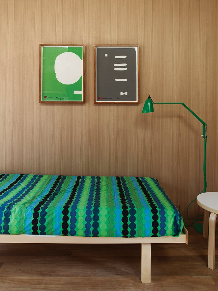 Bedroom, Bed, Medium Hardwood Floor, Night Stands, and Floor Lighting Räsymatto bedding by Marimekko in the studio is complemented by a green Anglepoise lamp from Sydney boutique Planet Furniture.  Photo 3 of 9 in Local Wood Clads Every Surface of This Idyllic Australian Getaway