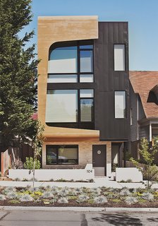 Green and Affordable Structure Fits Three Families in One 28-Foot-Wide Lot - Photo 1 of 11 - Architects Tiffany Bowie and Joe Malboeuf's Capitol Hill, Seattle, infill project was completed for $189 per square foot. Its street-facing facade is clad in prefinished siding from Taylor Metals, and cedar shaped and cut with CNC technology. The couple was inspired by the porthole windows of the Maritime Hotel in New York City, one of their favorite buildings.