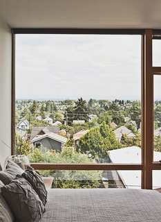 Green and Affordable Structure Fits Three Families in One 28-Foot-Wide Lot - Photo 4 of 11 - The third-floor master bedroom boasts sweeping views of Seattle.