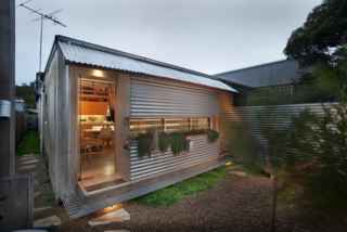 Compact Australian Home Clad in Steel and Concrete - Photo 1 of 10 -