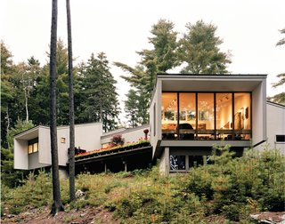 Viewed from a good distance down the slope running to the Union River, the Maison Amtrak is clearly oriented toward the river. The deck is sheltered from the neighbors' view by Cohen's bedroom to the right and the living room at left.