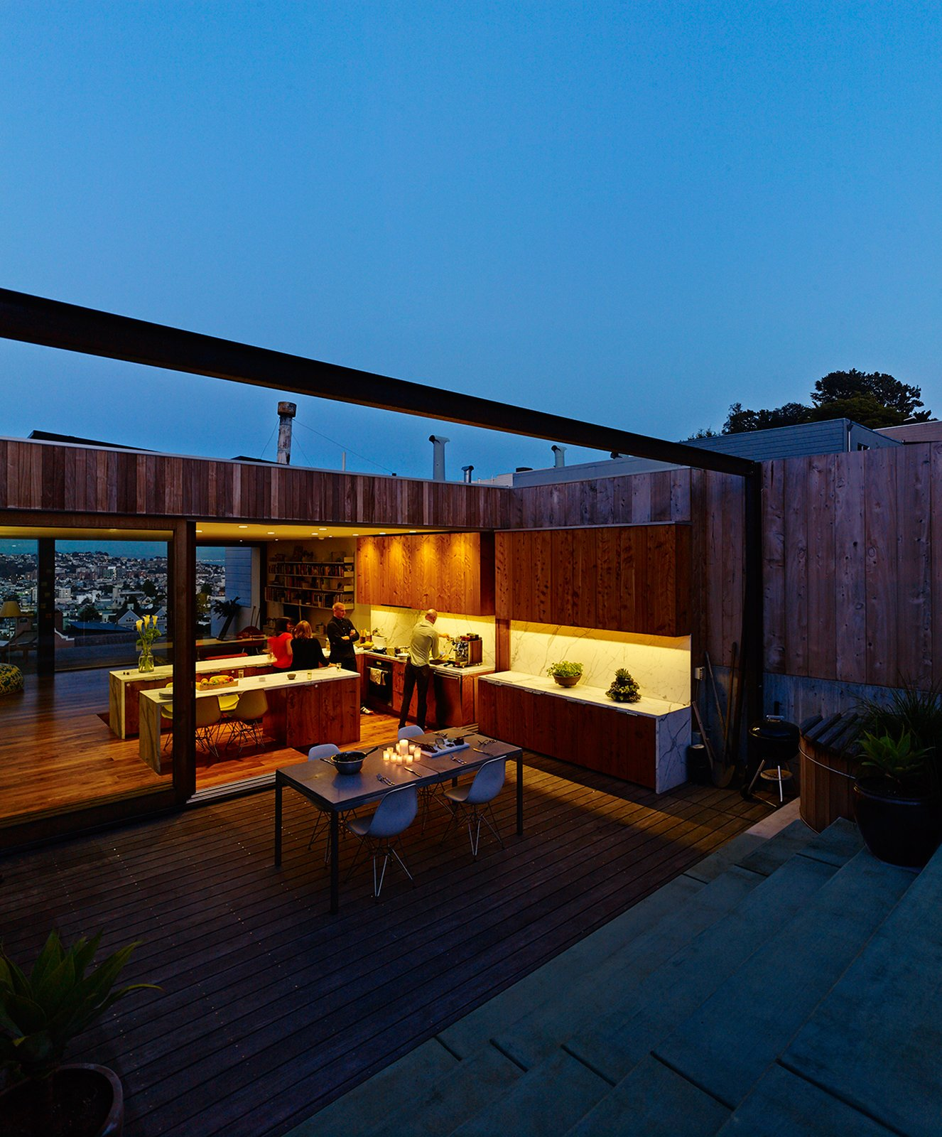 Exterior, Wood Siding Material, and House Building Type At night, opening the entire top floor is a breeze. Russell-Clarke and Moolsintong are even planning of rigging some kind of sail over the back patio for shade. The hot tub is by Roberts Hot Tubs.  Photo 15 of 17 in Striking Slatted Wood and Glass Home in San Francisco