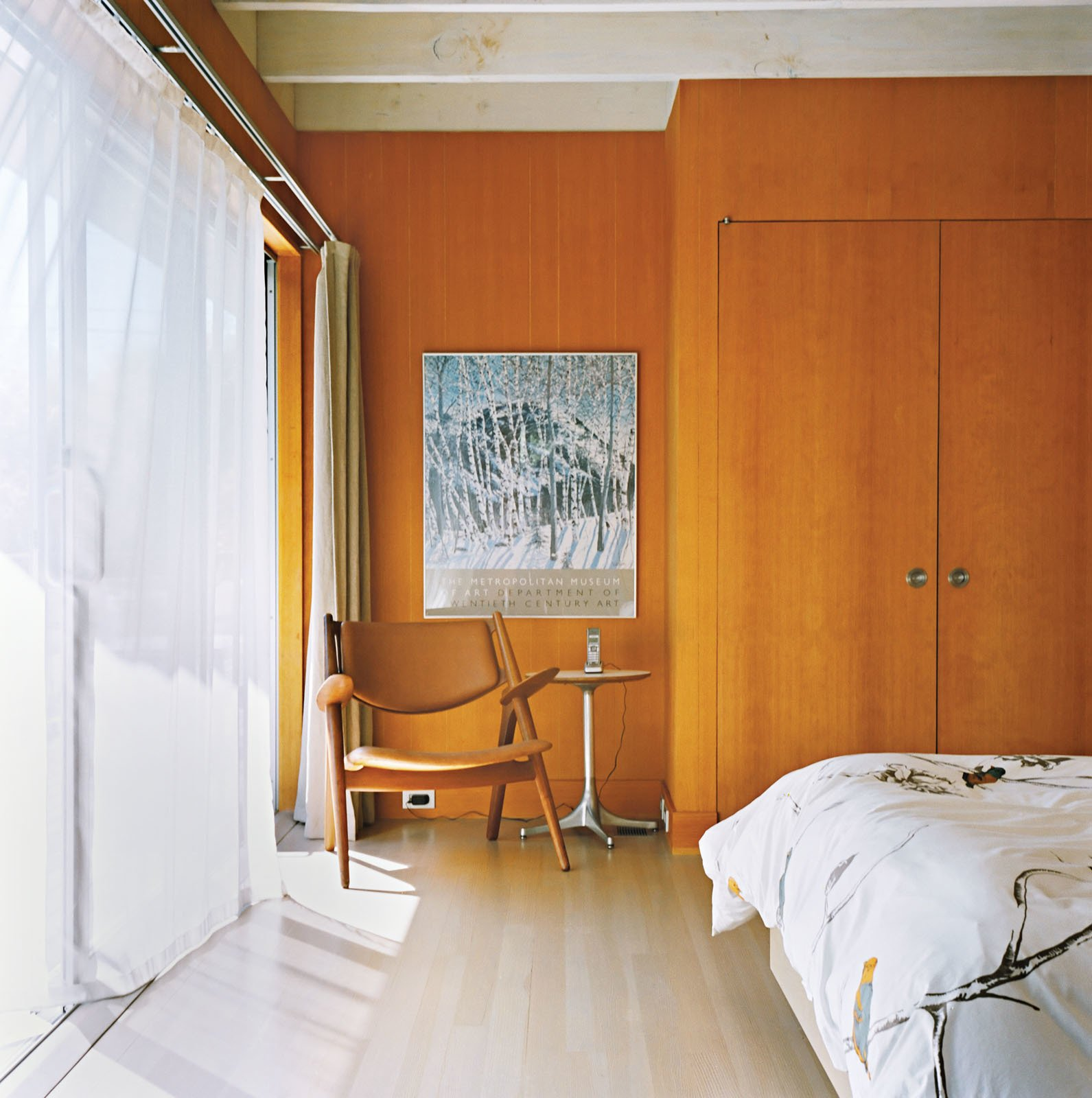 Bedroom, Light Hardwood Floor, Bed, and Chair Sheer curtains let light and breezes into the master bedroom.  Photo 4 of 12 in Long Island Found