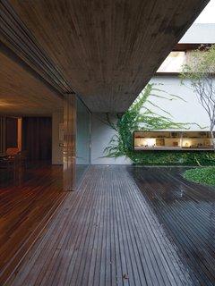 Four custom-built sliding doors divide indoor and outdoor spaces.