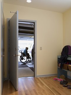 "The architects created a mudroom off the garage with plenty of room for quick turnarounds and busy family comings and goings. Much of the garage had been taken up by a large ramp before the concrete floor was repoured on a slope that meets with the house, eliminating the need for a more cumbersome ramp and allowing room for storage shelves. ""Your home is a place where you shouldn't have to put out too much effort, whether you're a person with a disability or not,"" says Braitmayer. ""You should be able to reserve all that energy and effort for the outside world."""