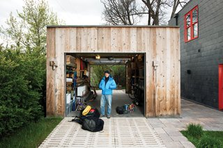 At a laid-back home in Bozeman, Montana, homeowner Brian Whitlock clad his tool shed with rustic wood. Two garage doors roll up for maximum flexibility from front to back, and simple light fixtures on the exterior are practical but also in keeping with the structure's design.