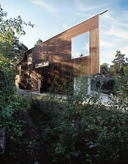 The Triangle House was completed in 2006, and its natural materials and geometric form equally embrace the surrounding forests and ocean. Photo by Ivan Brodey.