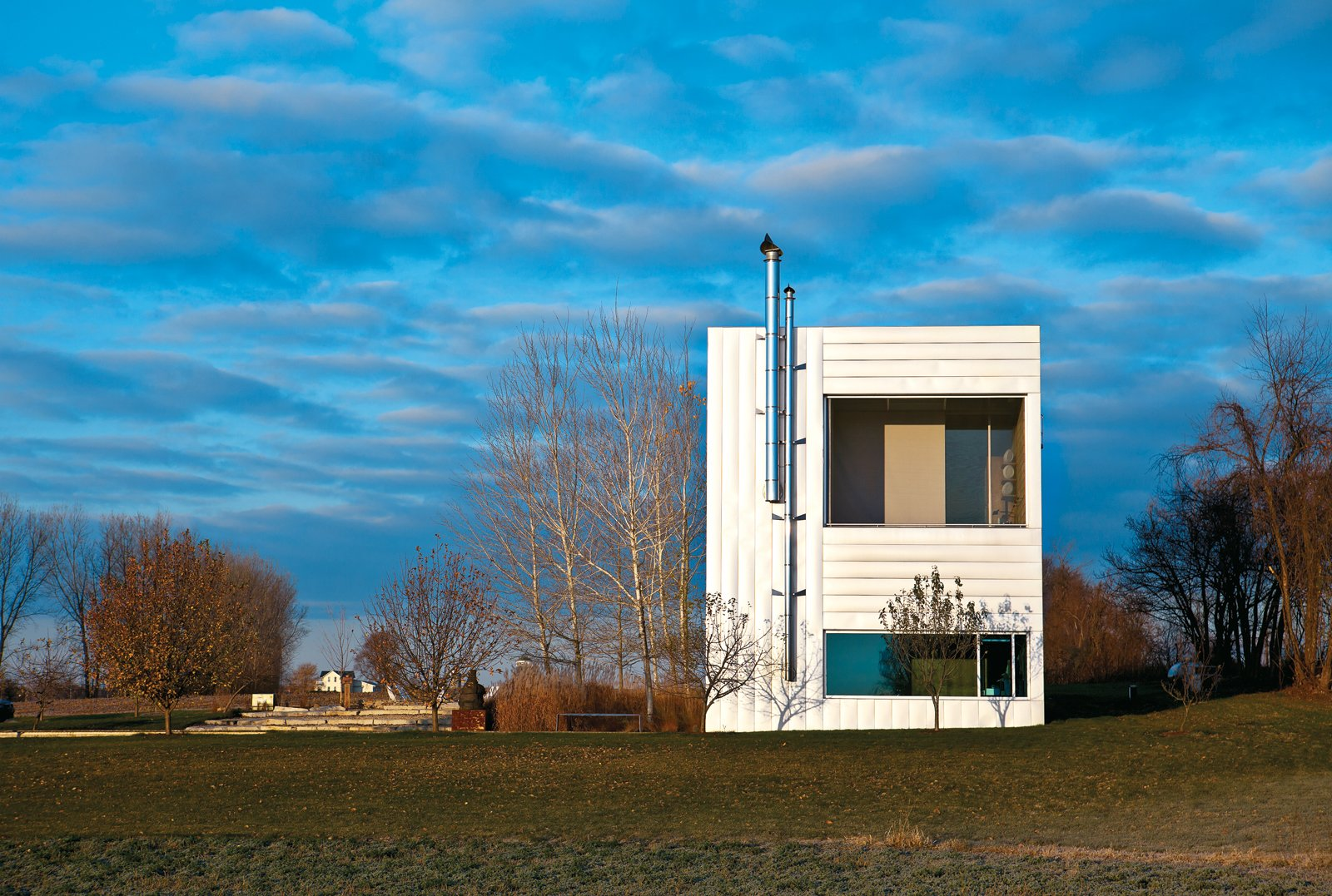 Exterior and Flat RoofLine The exterior of the Field House, designed by Wendell Burnette Architects in Ellington, Wisconsin.  Photo 1 of 10 in An Architect References Local Architecture to Build a Modern Home