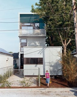 Julie Charvat of Bild Design exits the Lowerline House. Raised three feet off the ground—rather than slab on grade—the house is well equipped to battle any incoming flood waters.