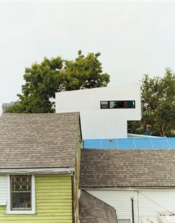 Though the Lowerline House may appear radically different, it deliberately mimics the neighboring shotgun camel-backs. The form is derived from a time when city taxes were based on the height of a building at the street front. To get more space but not get taxed, houses were built up on the rear of the property, problem solved.