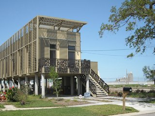 As one of 150 prefab houses in New Orleans designed by architecture firm KieranTimberlake, the home is storm-resistant, affordable, and sustainable. Plus, it seeks to represent the traditional architecture of the area in a modern way.